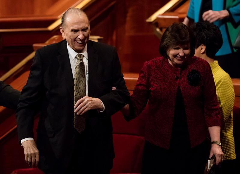 President Thomas S. Monson and his daughter, Ann M. Dibb, greet the crowd as he exits the Saturday morning session of general conference at the Conference Center in Salt Lake City, October 1, 2016.