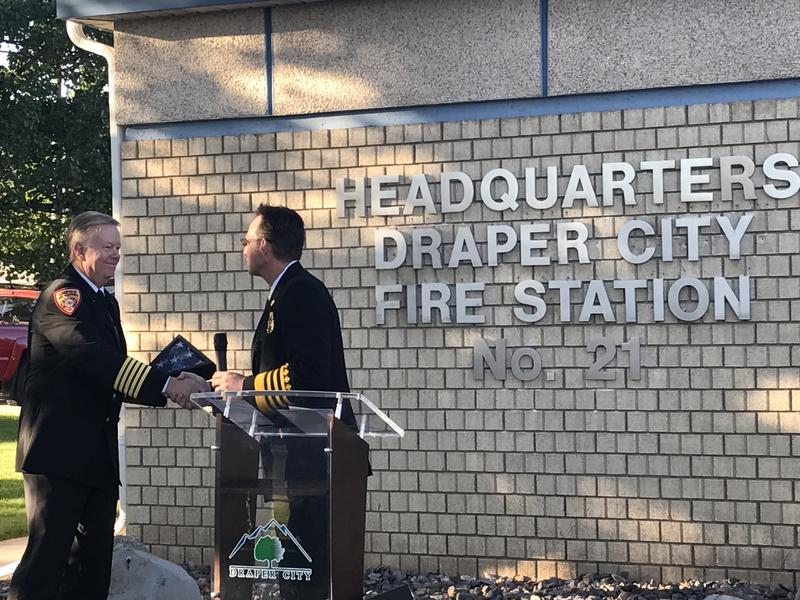 New Draper Fire Chief Clint Smith presents Unified Fire Authority Chief Dan Petersen with a flag. UFA transferred service of the community to the newly-formed Draper Fire Department on June 30, 2017.