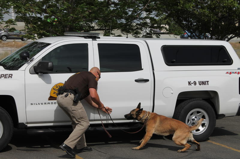 A Utah Highway Patrol officer demostrates how K-9's are used to seize narcotics from vehicles.