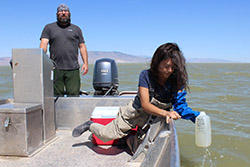 Suzan Tahir, an environmental scientist with the Utah Division of Water Quality, and Dax Reid, Provo River Watershed Coordinator for the Utah Department of Agriculture, sample Provo Lake water for cyanobacteria and the toxins they produce.