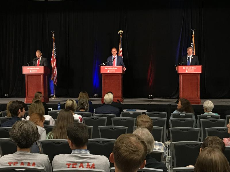 John Curtis, Tanner Ainge and Chris Herrod prepare to debate at the Utah Valley Convention Center on July 28, 2017.