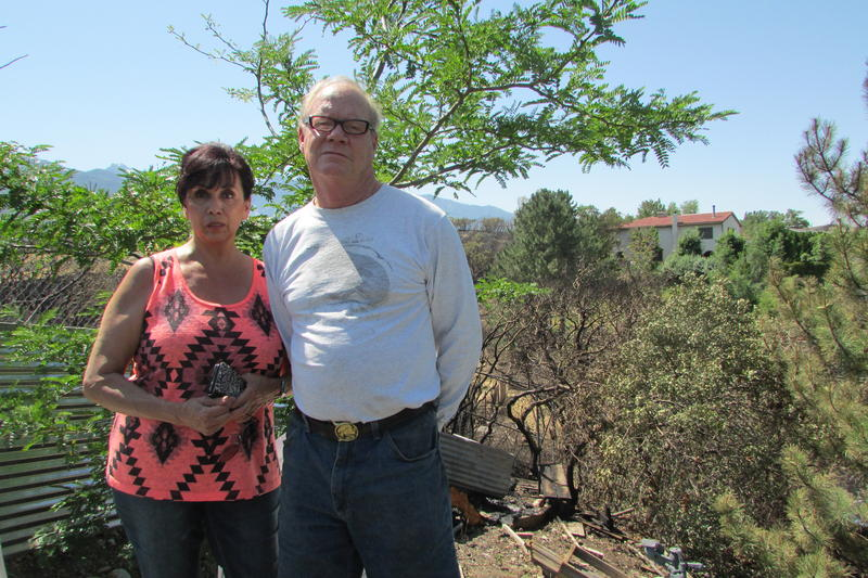 Margo and Chuck Lewis fled their home Tuesday when flames from a fireworks-sparked wildfire barreled toward their home during 4th of July celebrations Tuesday. They lost a pigeon coop, fences and some backyard trees.