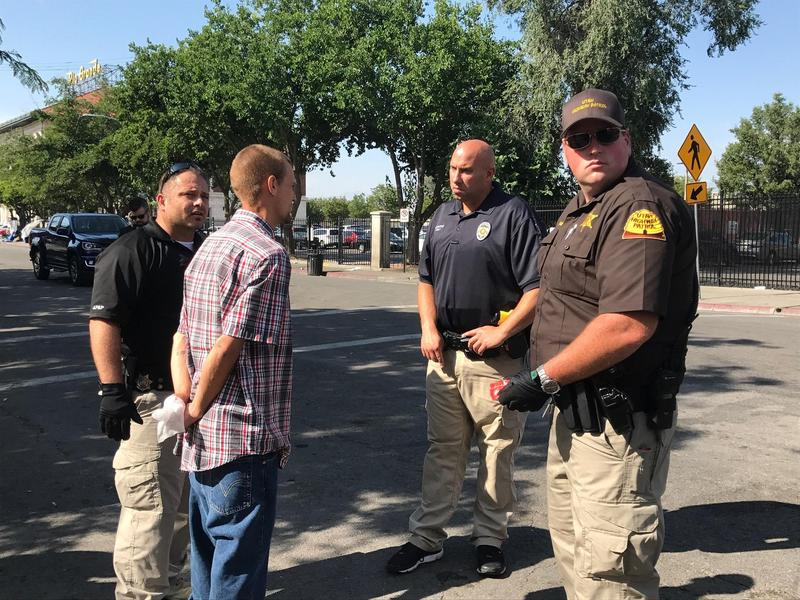 Officers make an arrest during the start of Operation Rio Grande, aimed at disrupting criminal activity near the Salt Lake's main homeless shelters.