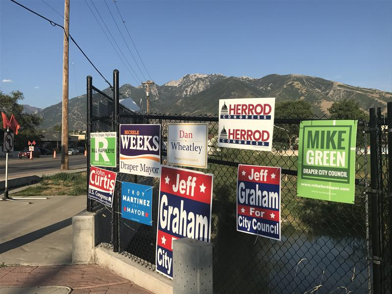 Campaign signs hanging in Draper.