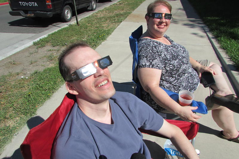 Warren Woodbury and Tanya Platt decided to enjoy a partial eclipse rather than totality traffic out of Idaho and Wyoming, where a more complete view was visible.