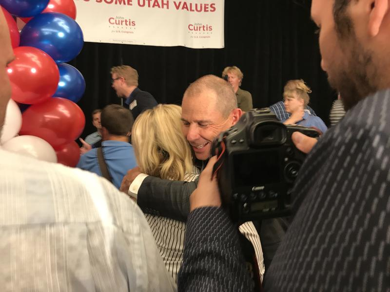 John Curtis hugs a supporter after winning the 3rd Congressional District primary on Aug. 15.