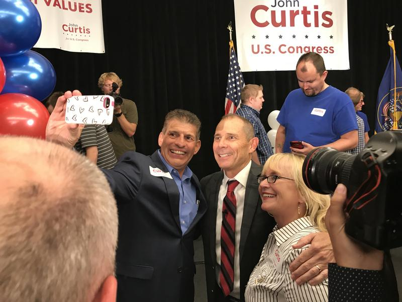 John Curtis poses for pictures with supporters after declaring victory in the 3rd Congressional District's primary race on August 15, 2017.