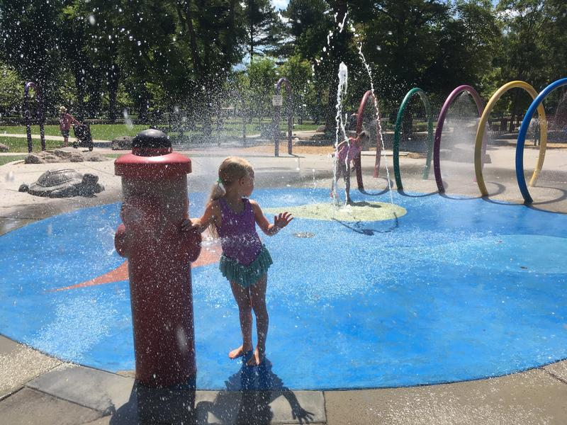 The Cope sisters beat the heat in the splash pad at Liberty Park. Record-hot temperatures have people of all ages looking for respite.
