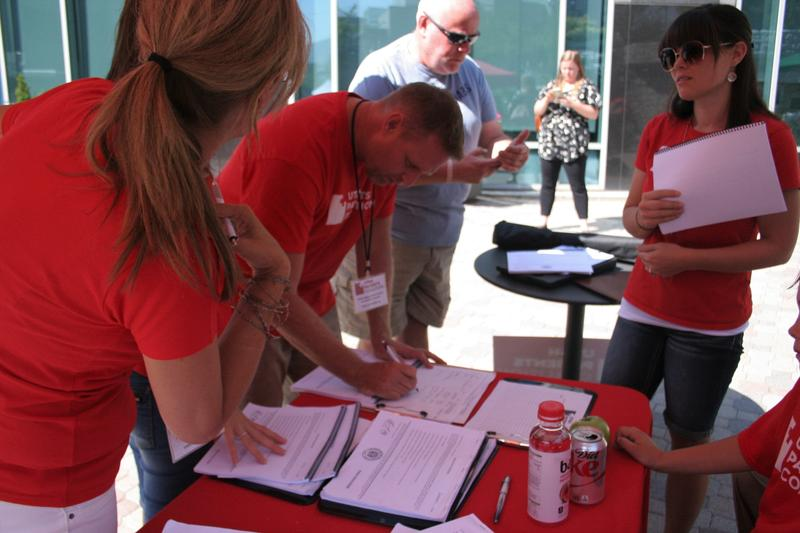 Members and volunteers Utah Patient Coalition started gathering signatures for a ballot initiative on Thursday. Left to right: DJ Schanz, Scott Kingsbury, and Lindsey Ohlin.