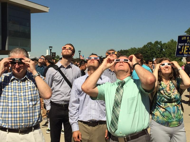 Onlookers viewed the partial solar eclipse at the University of Utah on Monday.