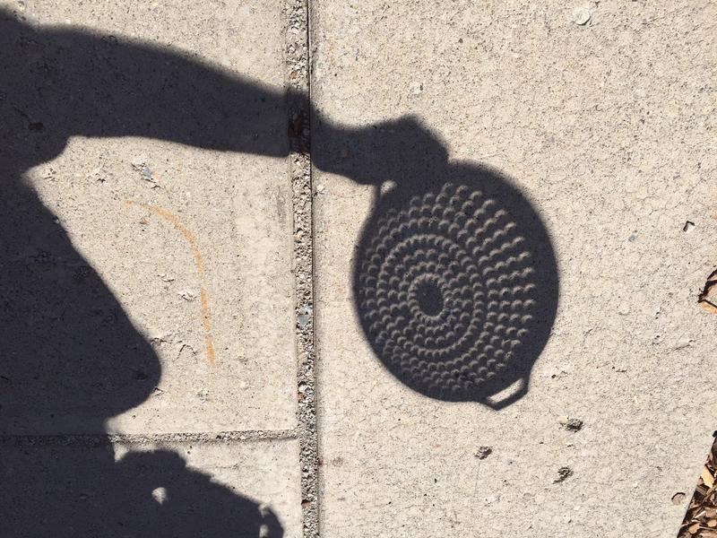 Crescent-shaped shadows were projected through this kitchen colander during the partial eclipse.