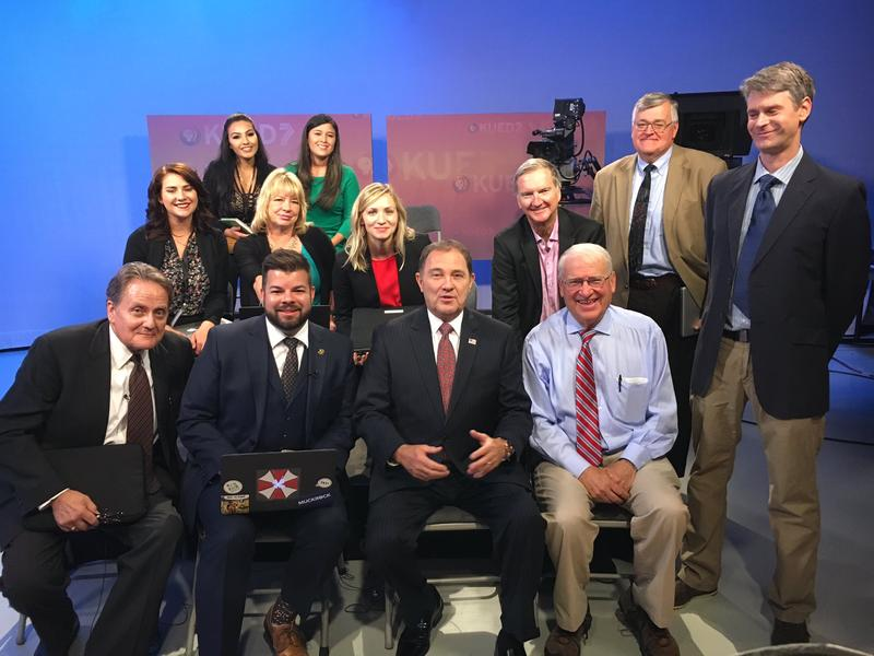Rod Decker, bottom right, during his final press conference with Gov. Gary Herbert. The veteran broadcast journalist signed off this week after 37 years.