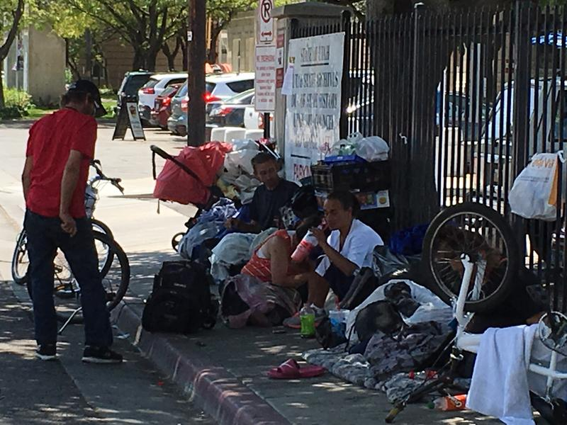 Homeless individuals congregate in the Rio Grande district.
