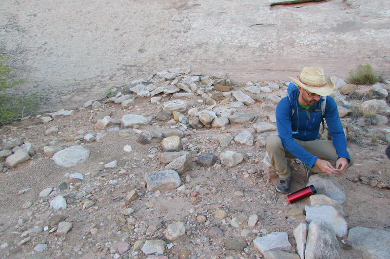 Josh Ewing, director of the Friends of Cedar Mesa, examines some pottery sherds in a midden in the Bears Ears National Monument. This area is rumored to be likely to fall outside the boundaries of the monument that's the White House is drawing up.