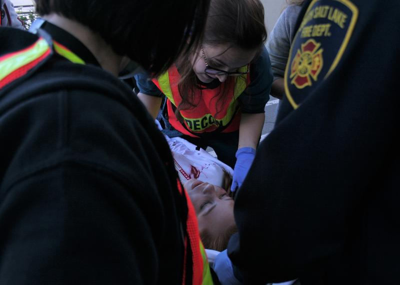 Nurses and first responders attend to a staged victim at Tuesday's disaster scenario.