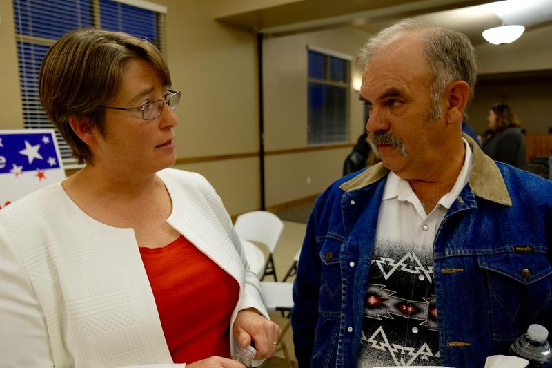 Physics professor and mayoral candidate Stacy Palen talks to voter Ned Allred at Marriott-Slaterville city's town hall.