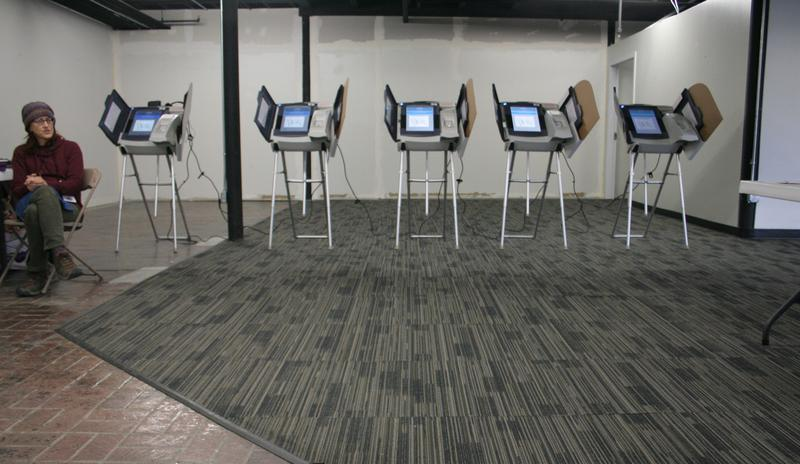 A polling location at Trolley Square in Salt Lake is mostly empty at the start of voting on Tuesday, Nov. 7.