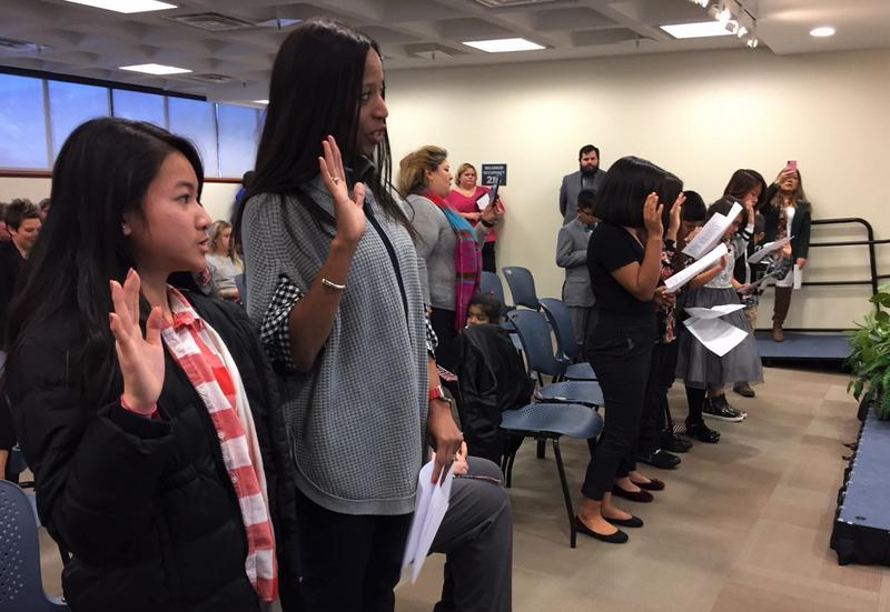 Congresswoman Mia Love recited the Oath of Allegiance along with ten children during a citizenship ceremony at the U.S. Citizenship and Immigration Services office in Salt Lake City on Thursday.