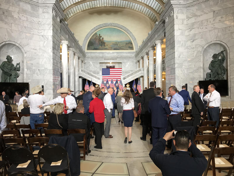 Utah elected officials and guests trickle into the Rotunda at the Utah State Capitol for President Trump's speech.