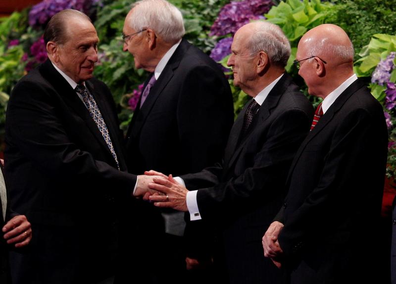 Thomas S. Monson (far left) shakes hands with Russell M. Nelson, the most senior apostle expected to take his place as president of the LDS Church.