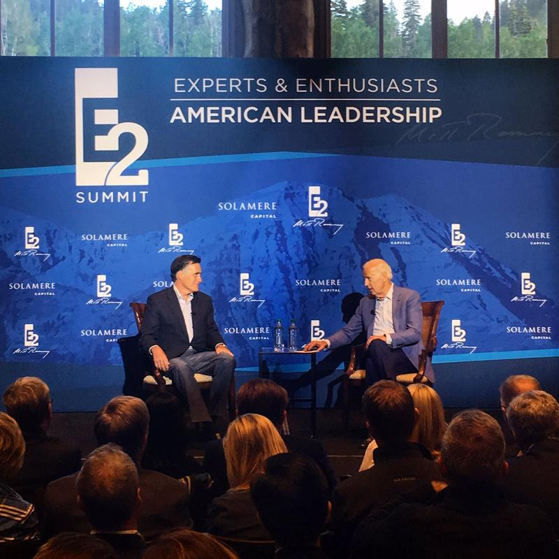 Former Vice President Joe Biden talks with Mitt Romney at his annual leadership summit in June 2017.