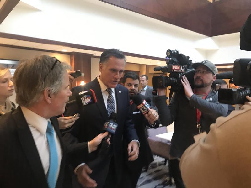 Mitt Romney speaks to reporters outside the Salt Lake Marriott on Tuesday, Jan. 16.