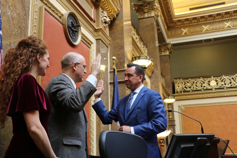 Rep. Travis Seegmiller (right) is sworn in by House Speaker Greg Hughes on Wednesday. The state's newest lawmaker will represent House District 62, left vacant last week by St. George Republican Jon Stanard after a sex scandal.