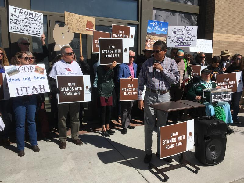 Dozens of people gathered outside the Bureau of Land Management's Salt Lake City offices to protest Tuesday's lease-sale in southeastern Utah. They said the area is too rich in cultural resources and natural beauty for drilling.