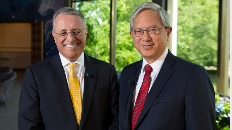 Elder Soares and Elder Gong pose together in suits and ties.