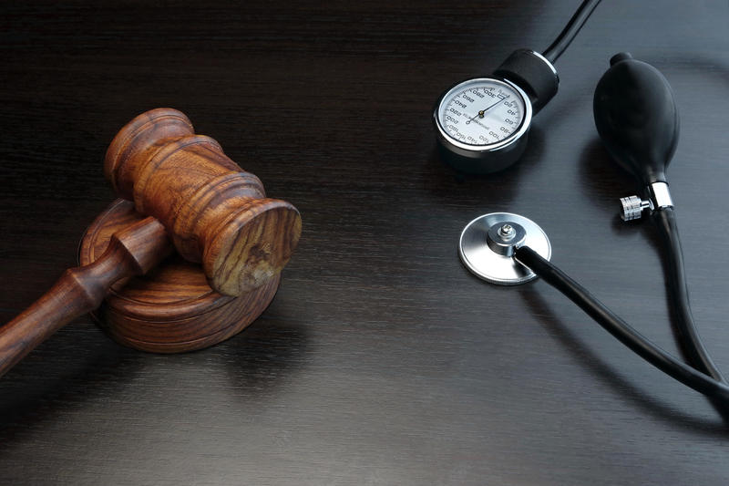 photo of gavel and stethoscope.