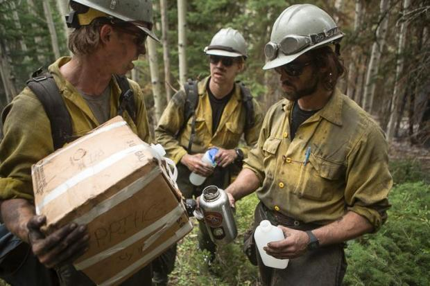 A photo of firefighters taking a water break at the Dollar Ridge Fire east of Strawberry Reservoir in Utah.