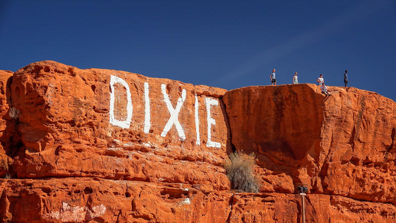 Red rocks with the word Dixie written in white paint.