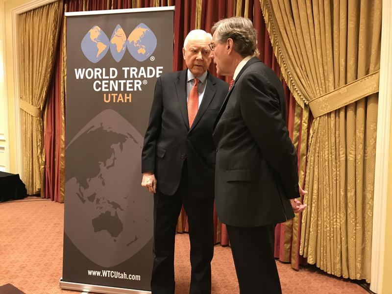 Sen. Orrin Hatch speaks with A. Scott Anderson, president of Zion's bank, before a World Trade Center of Utah symposium on the Trump administration's trade war.