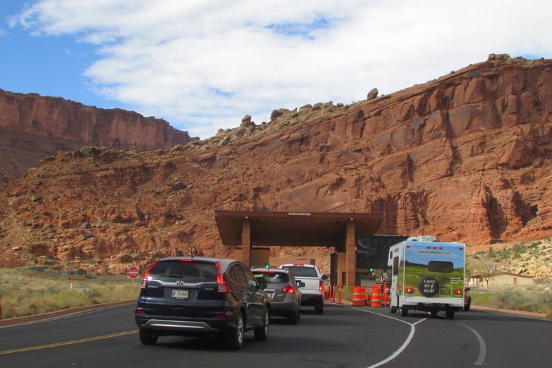 Photo of vehicles at Arches National Park entrance.
