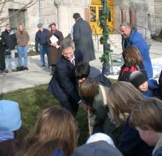 Salt Lake City Mayor Ralph Becker helps school kids plant a tree on the grounds of the City-County Building.