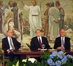 President Thomas S. Monson flanked by Henry B. Eyring, left, as first counselor and Dieter F. Uchtdorf, right, as second counselor in the LDS Church First Presidency.