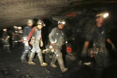 Workers attempt to reach trapped miners in the Crandall Canyon Mine August 7, 2007.