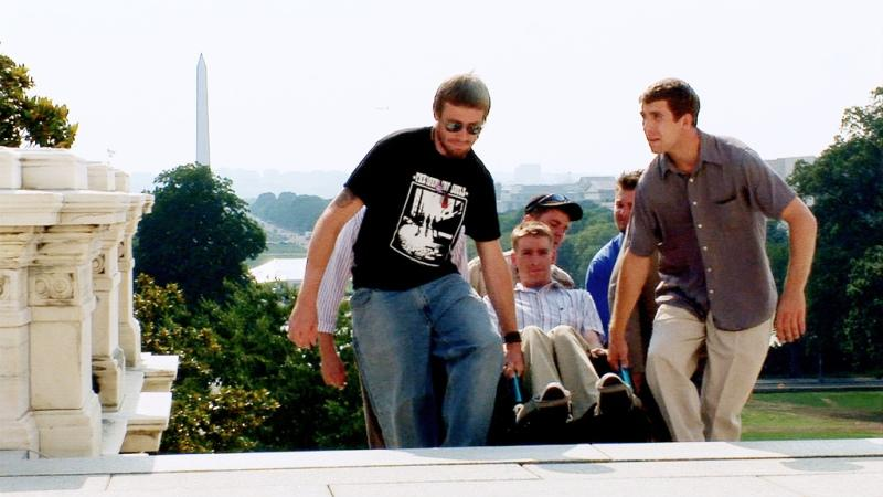 Iraq War veterans carry Tomas Young up the Capitol steps in Washington DC.