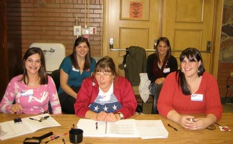MacGregor sisters work poll station.