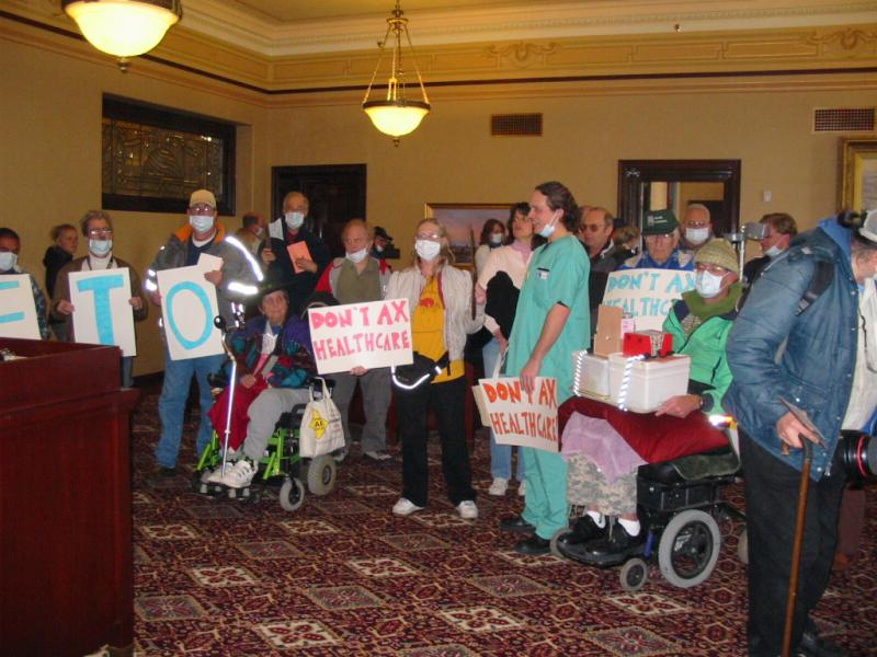 Medicaid recipients protest proposed cuts in Governor's office