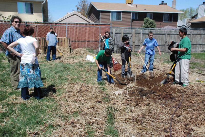 Students at Escalante Elementary School in Salt Lake City get their hands dirty during a gardening class.