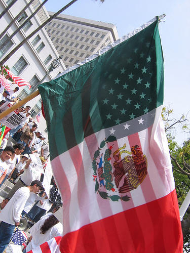 """American & Mexican Flags. Photo by <a href=\""""http://www.flickr.com/photos/victoriabernal/139236245/\"""" target=\""""_blank\"""">Victoria Bernal</a> on flickr.com"""