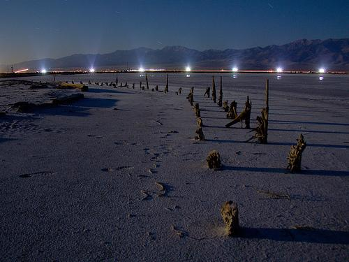 Lights along a road west of the Great Salt Lake.