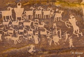 This hunting scene is among thousands of petroglyphs in Utah's Nine Mile Canyon.