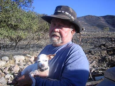 Val Johnson surveys destruction from the Herriman fire.