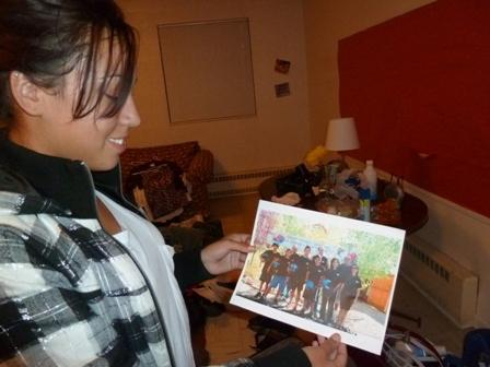 Mia Mora, 14, shows off a picture of her Mexican skeleton team. She and her mother are in temporary housing coordinated by the non-profit Family Promise.