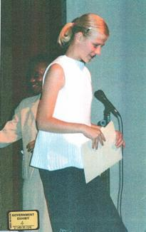 14-year-old Elizabeth Smart accepting a jr. high award. She was kidnapped later that night.