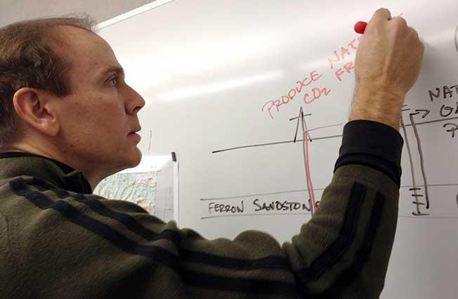 University of Utah Engineering Professor Brian McPherson draws a diagram of a carbon sequestration test.