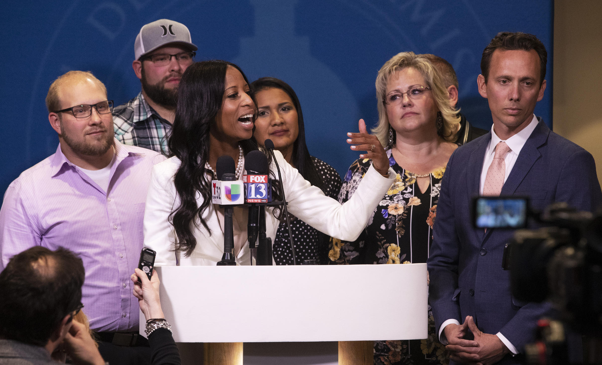 Rep. Mia Love stands with Josh Holt and his family after the debate with Ben Mc Adams during the 2018 midterm election. Pool