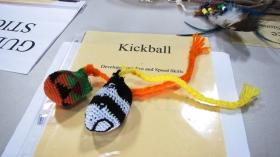 Kickballs can be made using different fabric, filled with sand and buffalo hair, or whatever you have on hand. They can also be made out of hacky sacks, like these pictured, by attaching a braided tail.